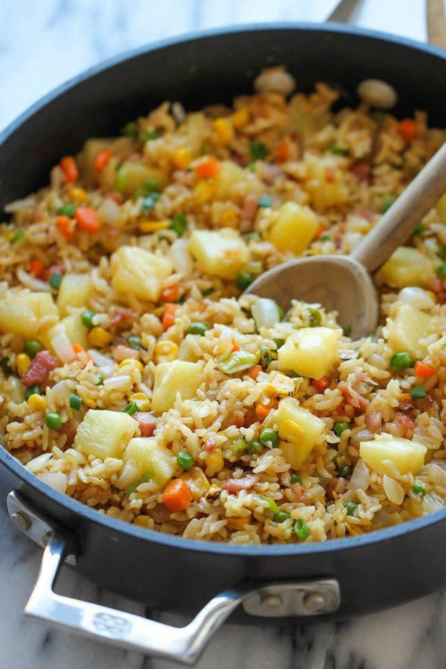 "<strong>Get the <a href=""http://damndelicious.net/2014/06/25/pineapple-fried-rice/"" rel=""nofollow noopener"" target=""_blank"" data-ylk=""slk:Pineapple Fried Rice recipe"" class=""link rapid-noclick-resp"">Pineapple Fried Rice recipe</a> from Damn Delicious</strong>"