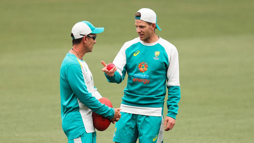 Australia captain Tim Paine can be seen here chatting to coach Justin Langer.