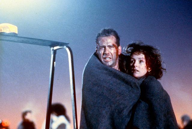 Bloodied Bruce Willis and Bonnie Bedelia wrapped in blanket in a scene from the film 'Die Hard 2', 1990. (Photo by 20th Century-Fox/Getty Images)