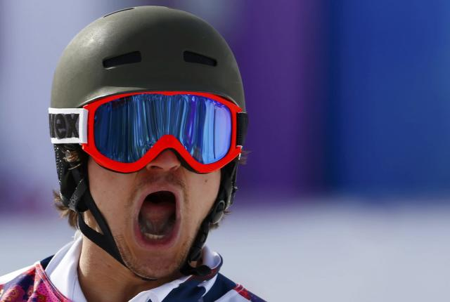 Russia's Vic Wild reacts during the men's parallel slalom snowboard finals at the 2014 Sochi Winter Olympic Games in Rosa Khutor February 22, 2014. REUTERS/Lucas Jackson (RUSSIA - Tags: OLYMPICS SPORT SNOWBOARDING)
