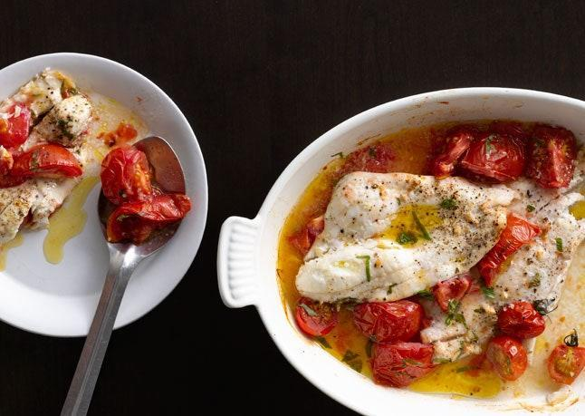 """The fish is baked in a simple herbaceous sauce. <a href=""""https://www.bonappetit.com/recipe/baked-flounder-tomatoes-basil?mbid=synd_yahoo_rss"""" rel=""""nofollow noopener"""" target=""""_blank"""" data-ylk=""""slk:See recipe."""" class=""""link rapid-noclick-resp"""">See recipe.</a>"""