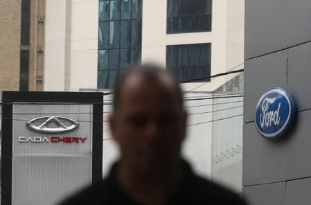 Logos of car manufacturers Caoa Chery and Ford are seen in front of dealerships of the companies in Sao Paulo