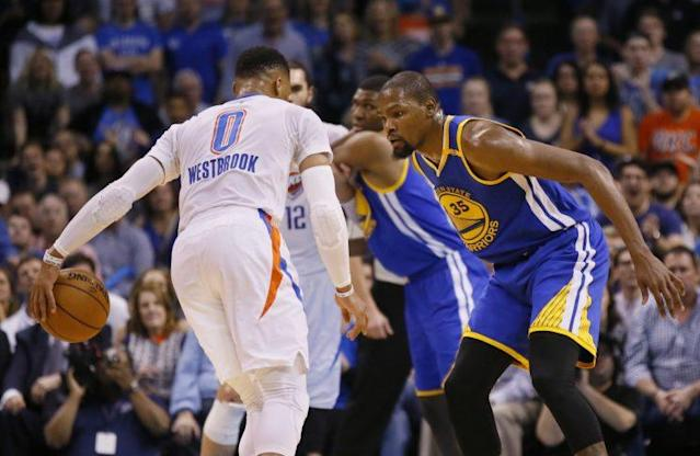 """<a class=""""link rapid-noclick-resp"""" href=""""/nba/players/4390/"""" data-ylk=""""slk:Russell Westbrook"""">Russell Westbrook</a> and <a class=""""link rapid-noclick-resp"""" href=""""/nba/players/4244/"""" data-ylk=""""slk:Kevin Durant"""">Kevin Durant</a> exchange pleasantries. (AP)"""
