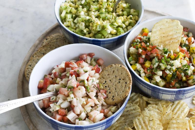In this image taken on June 3, 2013, from top clockwise, cucumber-corn salsa, apple-pepper salsa and strawberry-fennel salsa are shown served in bowls in Concord, N.H. (AP Photo/Matthew Mead)