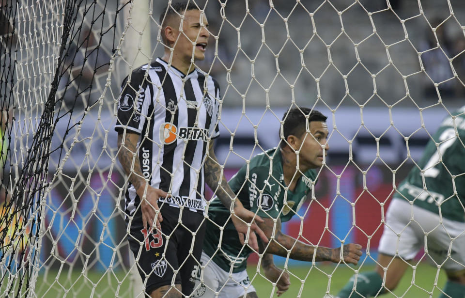 Dudu of Brazil's Palmeiras, right, celebrates after scoring his side's opening goal during a Copa Libertadores semifinal second leg soccer match against Brazil's Atletico Mineiro at the Mineirao stadium in Belo Horizonte, Brazil, Tuesday, Sept. 28, 2021. (Washington Alves/Pool via AP)