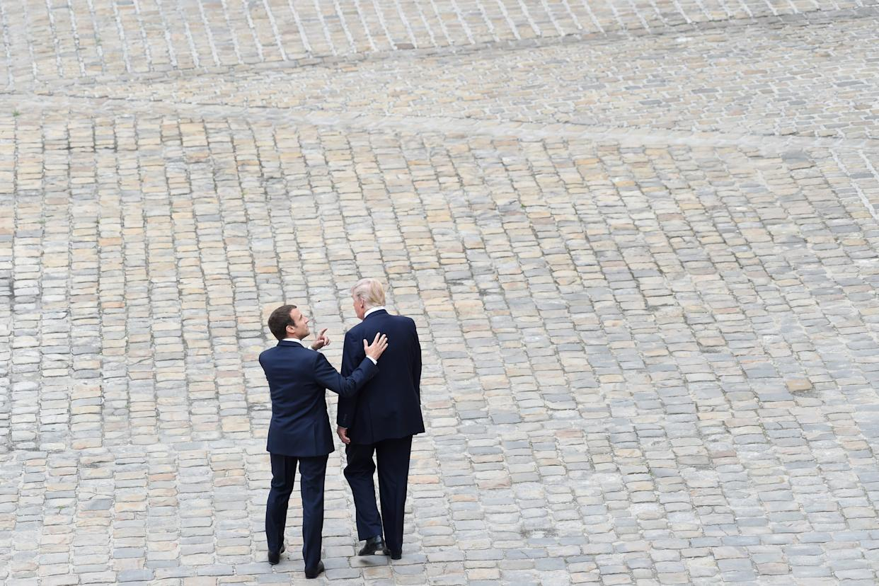 Trump is welcomed by French President Emmanuel Macron during a welcome ceremony at Les Invalides in Paris.