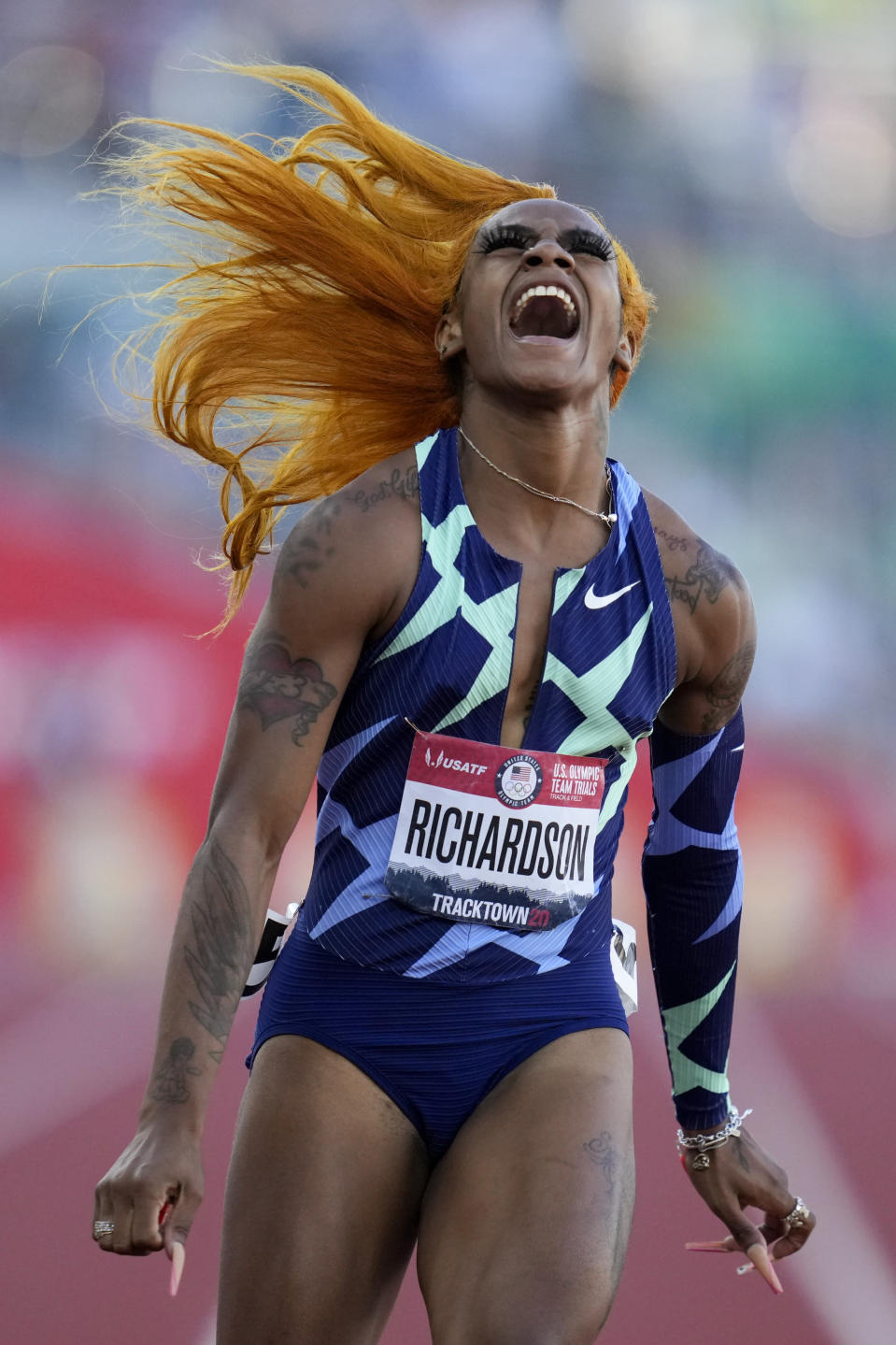 Sha'Carri Richardson celebrates after winning the women's 100-meter run at the U.S. Olympic Track and Field Trials Saturday, June 19, 2021, in Eugene, Ore. (AP Photo/Ashley Landis)