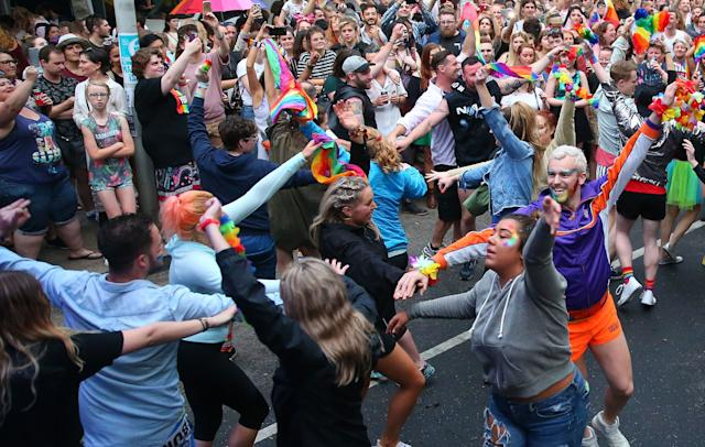 A 'flash mob' performs at a street party in Melbourne.