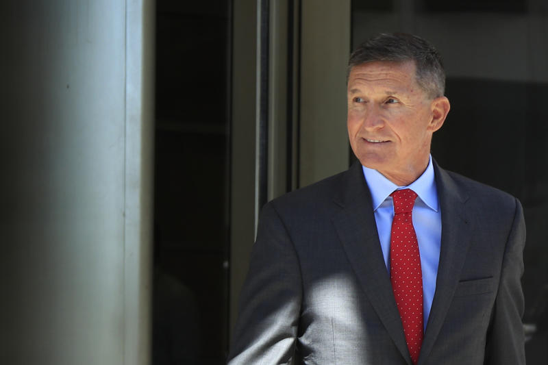 FILE - In this July 10, 2018, file photo, former Trump national security adviser Michael Flynn leaves the federal courthouse following a status hearing in Washington. A jury on Tuesday, July 23, 2019, has convicted Bijan Kian, a one-time business partner of former national security adviser Michael Flynn, on charges he illegally acted as a Turkish agent when he and Flynn undertook a project to discredit an exiled cleric wanted by Turkey's government.(AP Photo/Manuel Balce Ceneta, File)