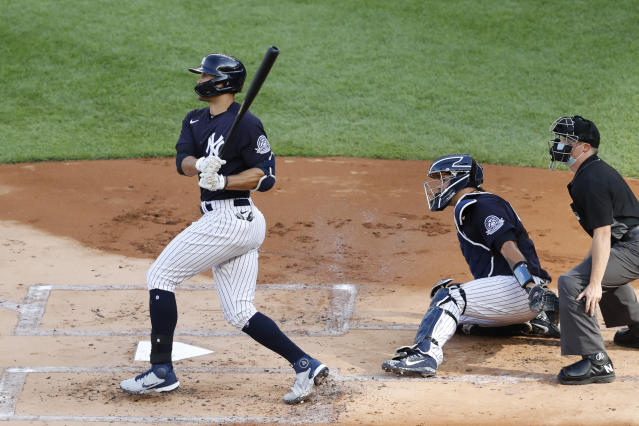 New York Yankees designated hitter Giancarlo Stanton, catcher Gary Sanchez and an umpire watch Stanton's solo home run off James Paxton during an intrasquad baseball game Wednesday, July 15, 2020, at Yankee Stadium in New York. (AP Photo/Kathy Willens)