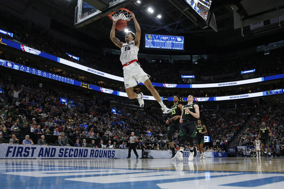 <p>Brandon Clarke #15 of the Gonzaga Bulldogs dunks the ball against the Baylor Bears during their game in the Second Round of the NCAA Basketball Tournament at Vivint Smart Home Arena on March 23, 2019 in Salt Lake City, Utah. (Photo by Tom Pennington/Getty Images) </p>
