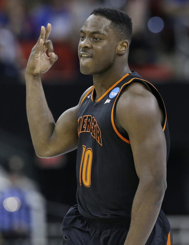 Mercer guard Ike Nwamu (10) celebrates his three-point shot against Duke during the first half of an NCAA college basketball second-round game, Friday, March 21, 2014, in Raleigh, N.C. (AP Photo/Gerry Broome)