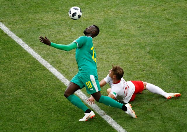 Soccer Football - World Cup - Group H - Poland vs Senegal - Spartak Stadium, Moscow, Russia - June 19, 2018 Senegal's M'Baye Niang in action with Poland's Lukasz Piszczek REUTERS/Kai Pfaffenbach