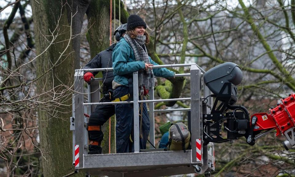 An HS2 protester in Euston Square Gardens is evicted during a police operation to remove them.