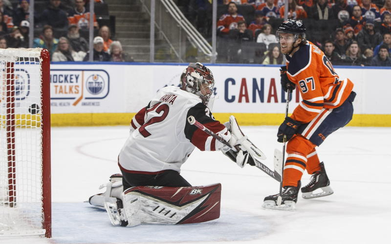 Arizona Coyotes goalie Antti Raanta (32) is scored on by Edmonton Oilers' Connor McDavid (97) during second period NHL action in Edmonton, Alberta, on Saturday, Jan. 18, 2020. (Jason Franson/The Canadian Press via AP)