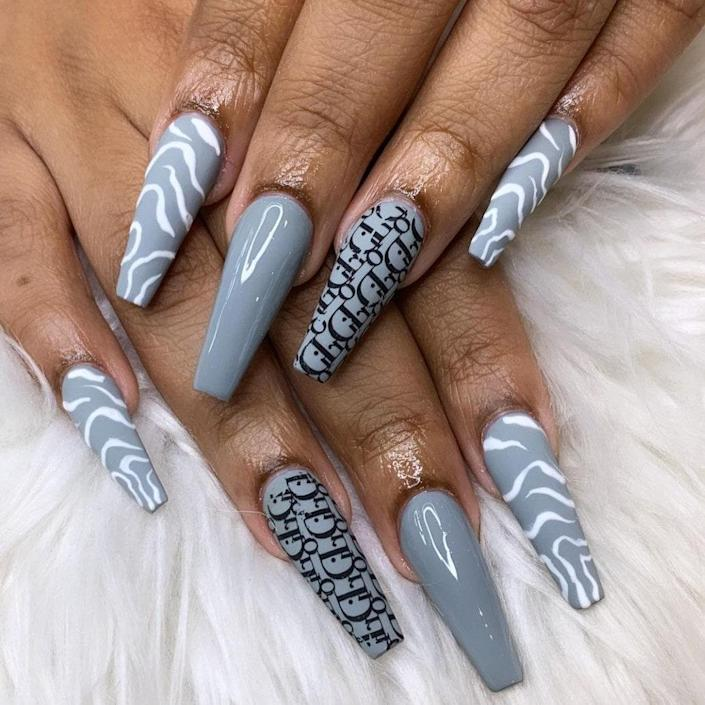 This gray manicure is anything but dreary with its Dior stickers and swirly white lines. We love how Lewis played around with different finishes, so the middle finger is nice and shiny while the other nails have a matte texture.