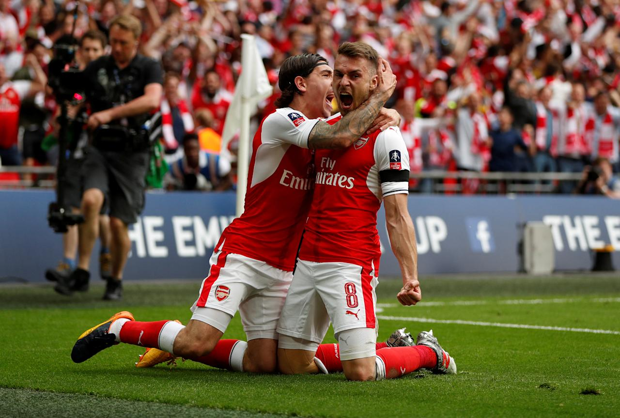 "Britain Soccer Football - Arsenal v Chelsea - FA Cup Final - Wembley Stadium - 27/5/17 Arsenal's Aaron Ramsey celebrates scoring their second goal with Hector Bellerin Action Images via Reuters / John Sibley EDITORIAL USE ONLY. No use with unauthorized audio, video, data, fixture lists, club/league logos or ""live"" services. Online in-match use limited to 45 images, no video emulation. No use in betting, games or single club/league/player publications.  Please contact your account representative for further details."