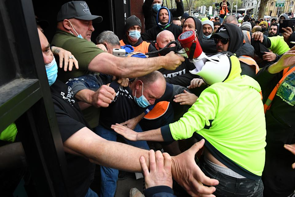 Construction workers clashed with unionists at a protest at Construction, Forestry, Maritime, Mining and Energy Union (CFMEU) headquarters in Melbourne. Source: AAP