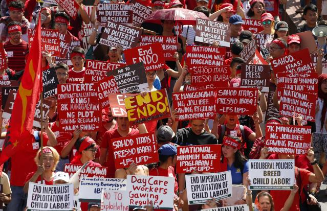 <p>Protesters, mostly workers, march towards the Presidential Palace during the global commemoration of Labor Day, May 1, 2018 in Manila, Philippines. About 5,000 workers and activists from various groups held a rally Tuesday near the Malacanang Palace to protest the failure of Philippine President Rodrigo Duterte to fulfill a major campaign promise to end contractualization, the widespread practice of short-term employment. (Photo: Bullit Marquez/AP) </p>