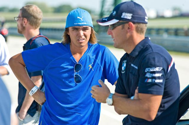CHICAGO, IL - SEPTEMBER 13: PGA TOUR professional Rickie Fowler gets driving tips from BMW American Le Mans Series race car driver, Joey Hand at the Autobahn Racetrack in Joliet, IL to kick-off the 2011 BMW Championship on September 13, 2011 in Joliet, Illinois. (Photo by Timothy Hiatt/Getty Images for BMW)