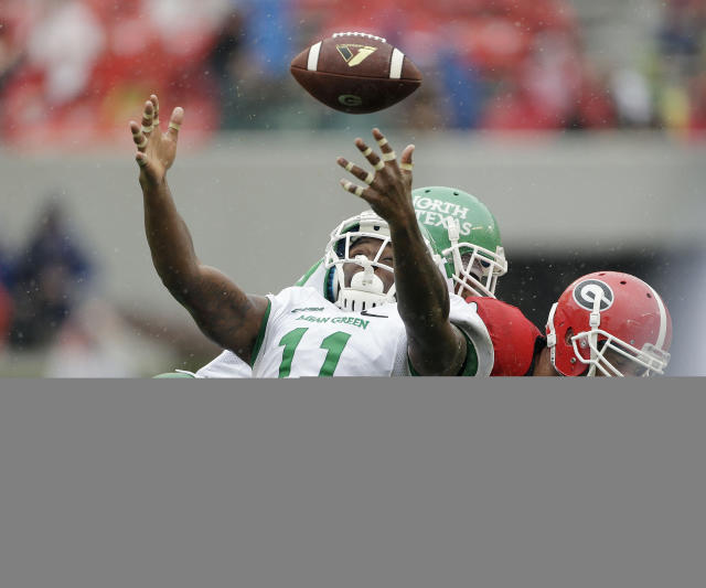 North Texas linebacker Will Wright (11) breaks up a pass intended for Georgia tight end Arthur Lynch (88) in the second half of an NCAA college football game Saturday, Sept. 21, 2013, in Athens, Ga. Georgia won 45-21. (AP Photo/John Bazemore)