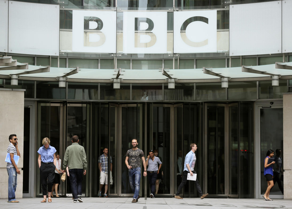 People arrive and depart from Broadcasting House, the headquarters of the BBC, in London Britain July 2, 2015. The BBC said it will cut more than 1,000 jobs because it expects to receive 150 million pounds ($234 million) less than forecast from the licence fee next financial year as viewers turn off televisions and watch programmes on the Internet.  REUTERS/Paul Hackett