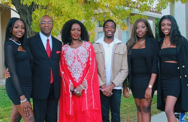 PHOTO:Evelyn Uba, her husband and four children gather for a family photo. (Courtesy Naeche Vincent)