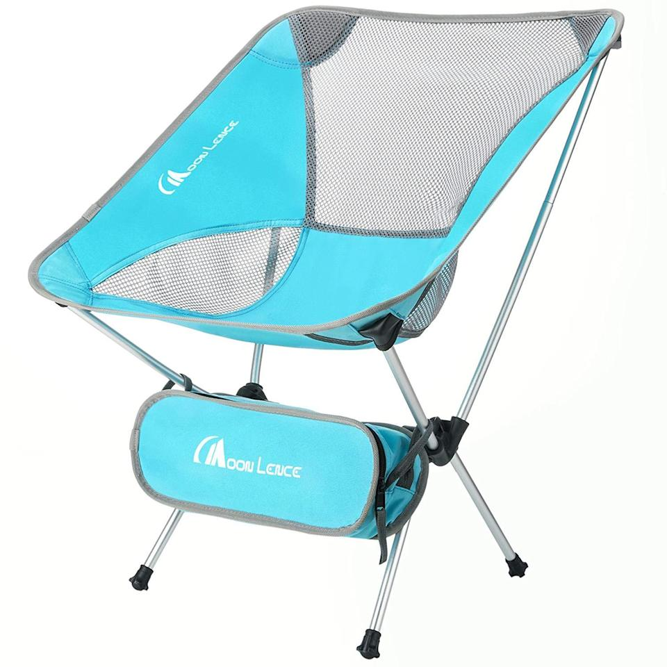 """<h3><h2>Moon Lence Ultralight Folding Chair</h2></h3><br>For those wanting the lightest of the light, this ergonomic chair is made with a high-strength aluminum alloy frame to provide durable support that only weighs two pounds total — customers can attest that it's a """"Great little beach chair. Compact and lightweight. Good if you need to walk a ways to your destination. Easily fits in a drawstring backpack with a towel.""""<br><br><em>Shop</em> <strong><em><a href=""""https://amzn.to/3o6TUOU"""" rel=""""nofollow noopener"""" target=""""_blank"""" data-ylk=""""slk:MOON LENCE"""" class=""""link rapid-noclick-resp"""">MOON LENCE</a></em></strong><br><br><strong>MOON LENCE</strong> Ultralight Portable Folding Chair With Carry Bag, $, available at <a href=""""https://amzn.to/2Qftka4"""" rel=""""nofollow noopener"""" target=""""_blank"""" data-ylk=""""slk:Amazon"""" class=""""link rapid-noclick-resp"""">Amazon</a>"""