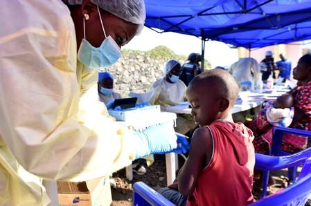 FILE PHOTO: A Congolese health worker administers ebola vaccine to a child at the Himbi Health Centre in Goma