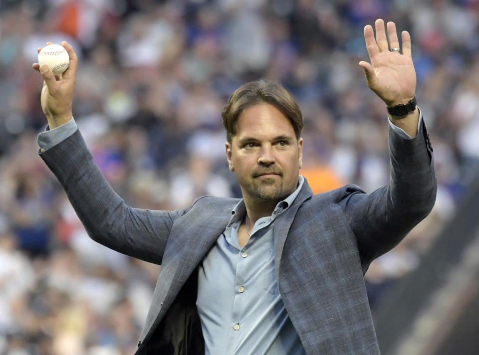 Former New York Mets catcher Mike Piazza acknowledges the fans before throwing out the ceremonial first pitch before a Mets baseball game against the New York Yankees, Saturday, June 9, 2018, in New York. (AP Photo/Bill Kostroun)