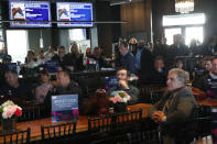 Attendees watch during the draw for the Pegasus World Cup Horse Race, Wednesday, Jan. 22, 2020, in Hallandale Beach, Fla. The race will run Saturday, Jan. 25 at Gulfstream Park in Hallandale Beach. (AP Photo/Wilfredo Lee)