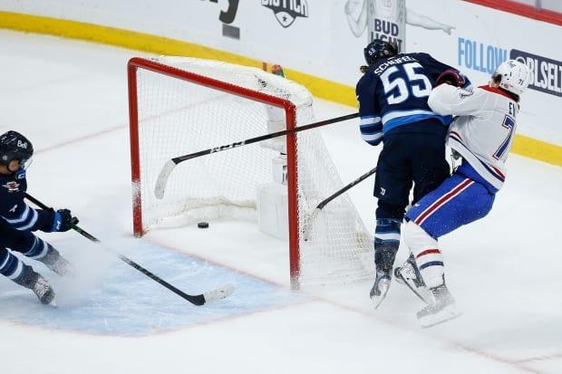 Winnipeg's Mark Scheifele was suspended four games on Thursday for his hit against Montreal forward Jake Evans during the final minute of Game 1 between the Jets and Montreal Canadiens. (John Woods/The Canadian Press - image credit)