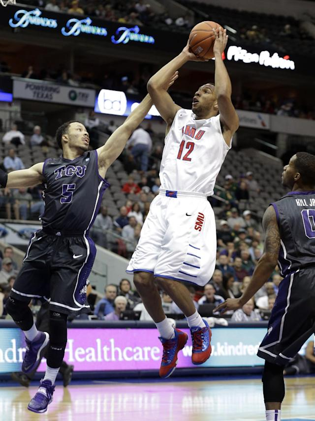 SMU guard Nick Russell (12) shoots against TCU guard Kyan Anderson (5) during the first half of an NCAA college basketball game in Dallas, Friday, Nov. 8, 2013. (AP Photo/LM Otero)