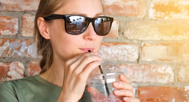 Takeaway drinks will no longer be able to be sold with single-use straws early next year. Source: Getty Images