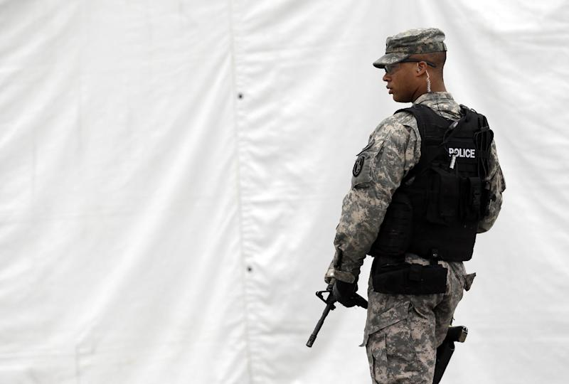 A military police officer stands guard outside of a courthouse in Fort Meade, Md., Monday, June 3, 2013, on the first day of Army Pfc. Bradley Manning's court martial. Manning, who was arrested three years ago, is charged with indirectly aiding the enemy by sending troves of classified material to WikiLeaks. He faces up to life in prison. (AP Photo/Patrick Semansky)