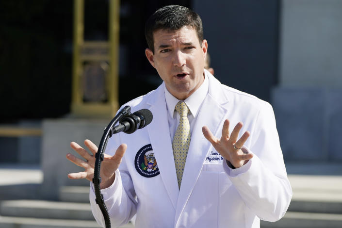 Dr. Sean Conley, physician to President Trump, briefs reporters at Walter Reed National Military Medical Center in Bethesda, Md. (AP Photo/Jacquelyn Martin)