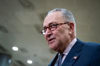 U.S. Senate Majority Leader Chuck Schumer (D-NY) speaks to reporters during a break during the second day of proceedings in the second impeachment trial of former U.S. President Donald Trump