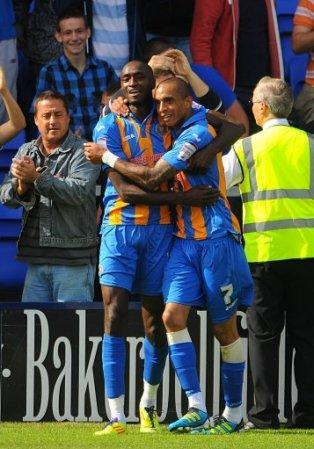Shrewsbury Town's Marvin Morgan celebrates scoring his side's third goal of the game with teammate Mark Wright (right)
