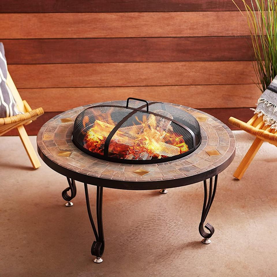 <p>If you have a warm-toned, natural-leaning aesthetic, you'll love this portable <span>Amazon Basics 34-Inch Natural Stone Fire Pit With Copper Accents</span> ($163).</p>