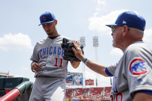 Chicago Cubs starting pitcher Yu Darvish (11) is congratulated by manager Joe Maddon, right, after closing the second inning of a baseball game against the Cincinnati Reds, Sunday, May 20, 2018, in Cincinnati. (AP Photo/John Minchillo)