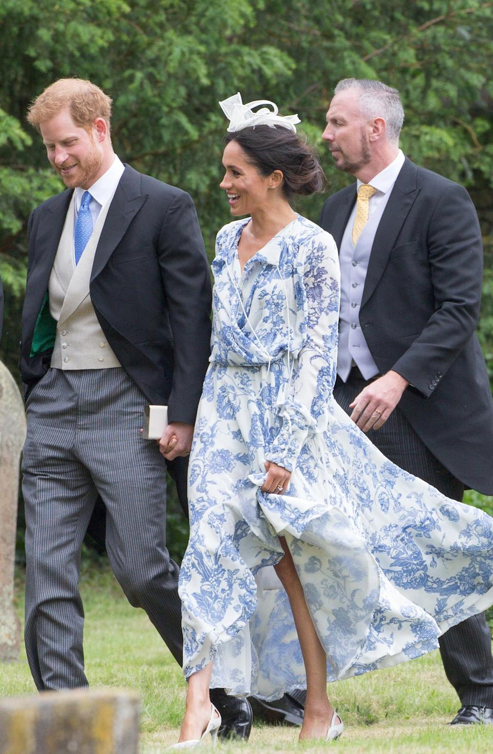 <p>For the wedding of Celia McCorquodale in Lincolnshire, the Duchess wore a relaxed, floral Oscar de la Renta dress with an M&S fascinator. <em>[Photo: Geoff Robinson Photography]</em> </p>