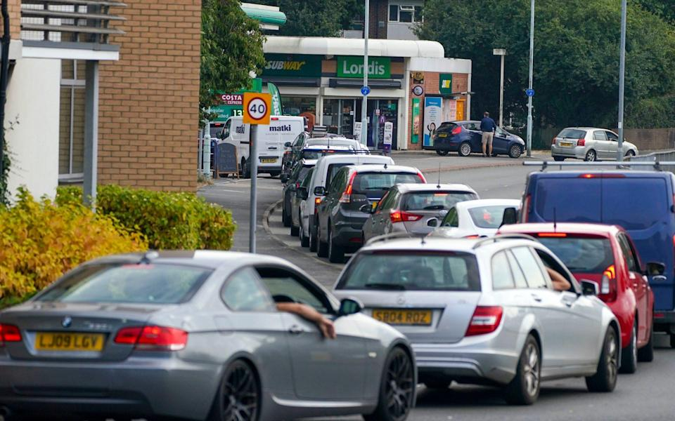 Cars queue for fuel at a BP petrol station in Bracknell, Berkshire - PA