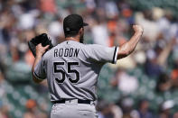 Chicago White Sox starting pitcher Carlos Rodon reacts after giving up a double to Detroit Tigers' Eric Haase during the seventh inning of a baseball game, Sunday, June 13, 2021, in Detroit. (AP Photo/Carlos Osorio)