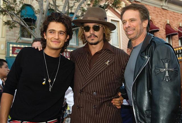 <p>Bloom and Depp pose with franchise producer Jerry Bruckheimer. (Photo: Chris Pizzello/AP) </p>