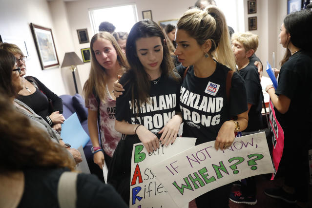 <p>Lital Donner, youth director for Congregation Kol Tikvah, comforts Aria Siccone, 14, a 9th grade student survivor from Marjory Stoneman Douglas High School, where over a dozen were killed in a mass shooting on Wednesday, after Aria told her story of that day to a legislator, as they challenge lawmakers in the state capitol on gun control reform, in Tallahassee, Fla., Wednesday, Feb. 21, 2018. (Photo: Gerald Herbert/AP) </p>