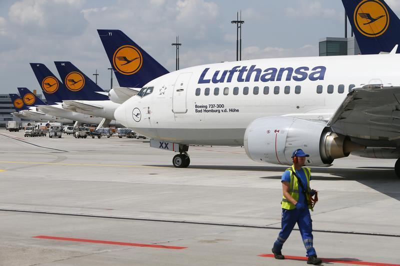 A Lufthansa Boeing 737-300 taxis across the tarmac of Frankfurt airport