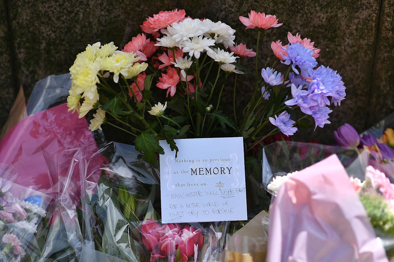 <p>Floral tributes in St Ann's Square in Manchester, northwest England, on May 23, 2017, laid as a mark of respect to those killed and injured in a deadly terror attack at the Ariana Grande concert at the Manchester Arena on May 22. (Photo: Ben Stansall AFP/Getty Images) </p>
