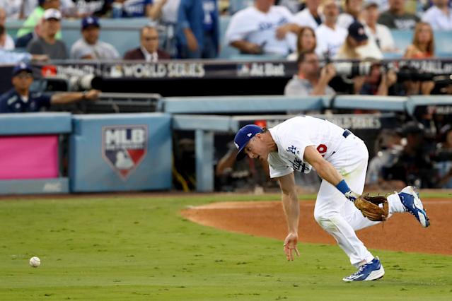 <p>Chase Utley #26 of the Los Angeles Dodgers attempts to field a ball during the third inning against the Houston Astros in game two of the 2017 World Series at Dodger Stadium on October 25, 2017 in Los Angeles, California. (Photo by Ezra Shaw/Getty Images) </p>