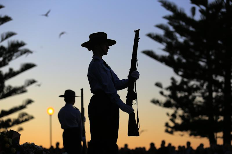Members of the 324 Squadron stand in formation during the ANZAC Day Dawn Service at Coogee Beach in Sydney. Source: AAP