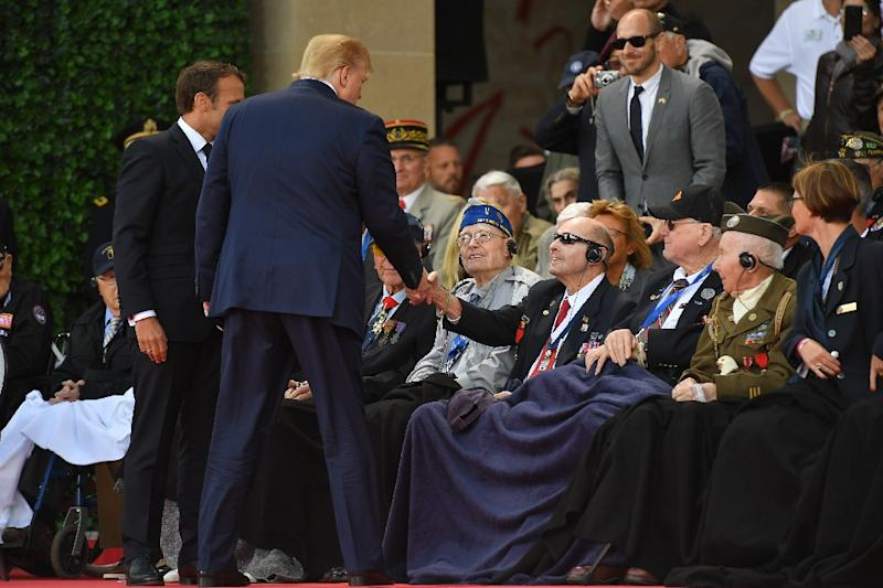 Trump greeted US veterans in Normandy - they hailed his administration's move to give veterans access to private care (AFP Photo/MANDEL NGAN)
